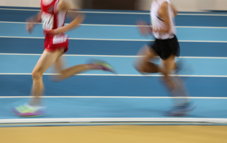 Men running track-Performance of Experience