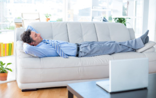 LLI-Energy Efficient Introvert-Businessman lying on couch in living room