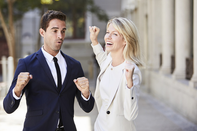 The Dance of Egos-Communication-Funny business people dancing in street smiling