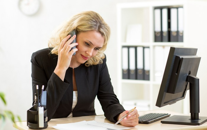 The Ins and Outs of Client Interviews-Business woman working in office. Worker talking by phone and wr
