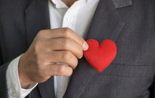 LLI Four Letter Words-Nice vs Kind-businessman heart in pocket
