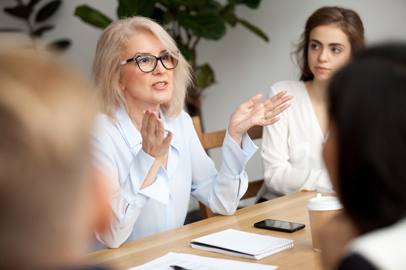 Leading Up-Attractive Aged Businesswoman, Teacher Or Mentor Coach Speaking