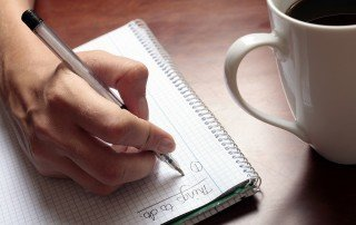 Not Enough Time List-Womans hand with pen notebook and coffee